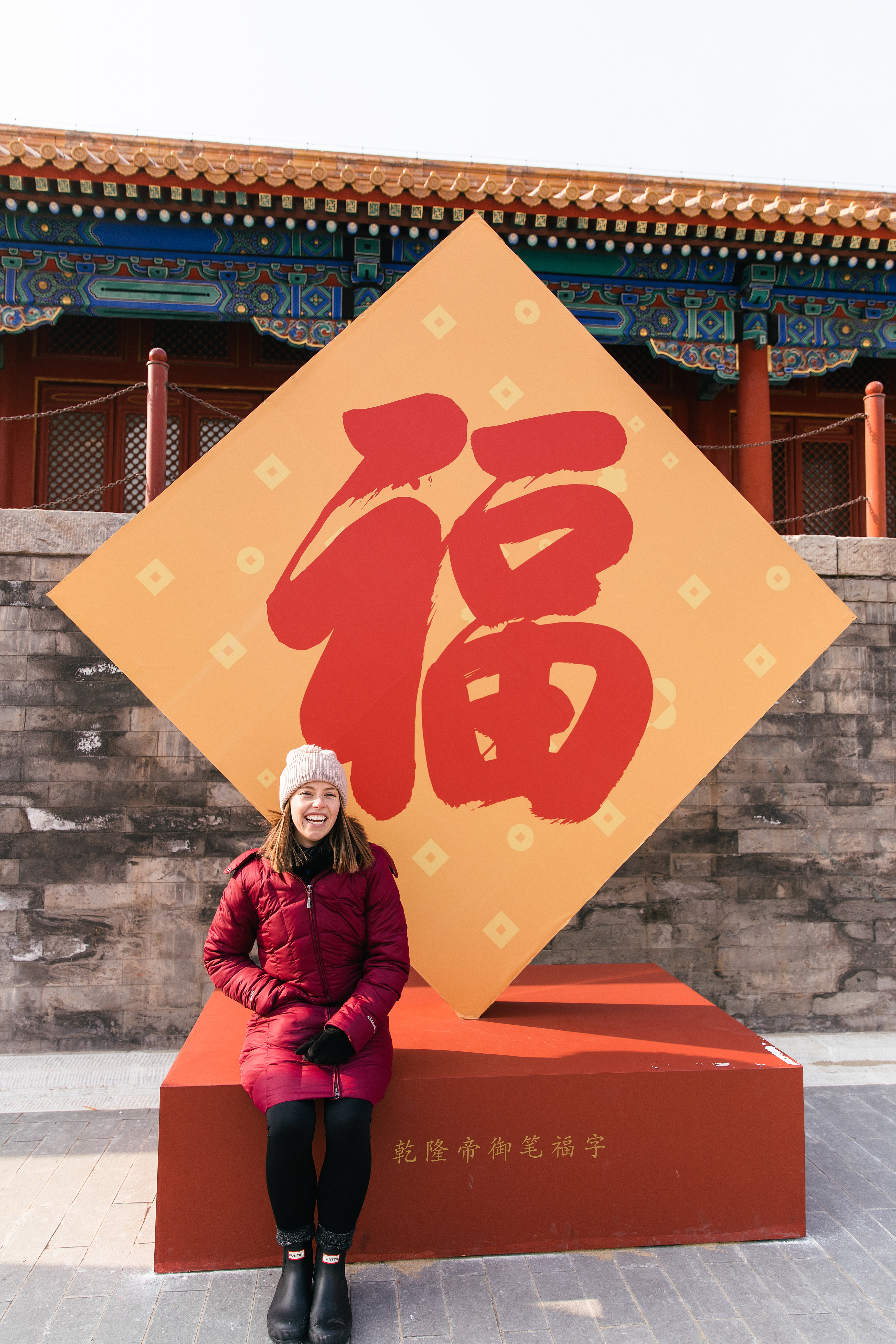girl in front of Chinese sign