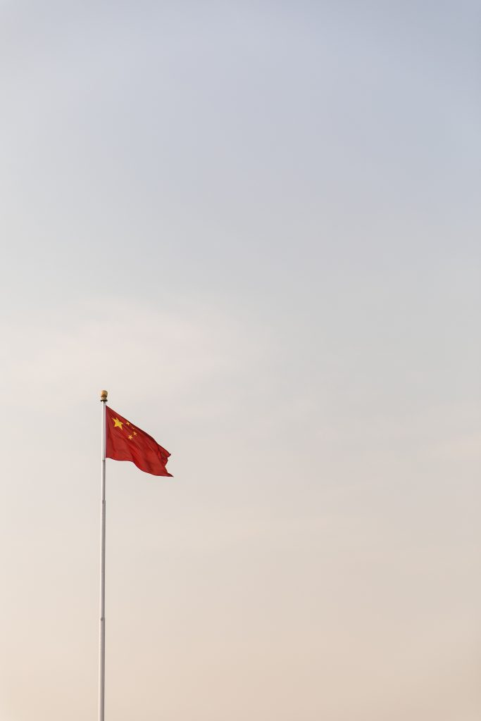 Chinese flag against sky