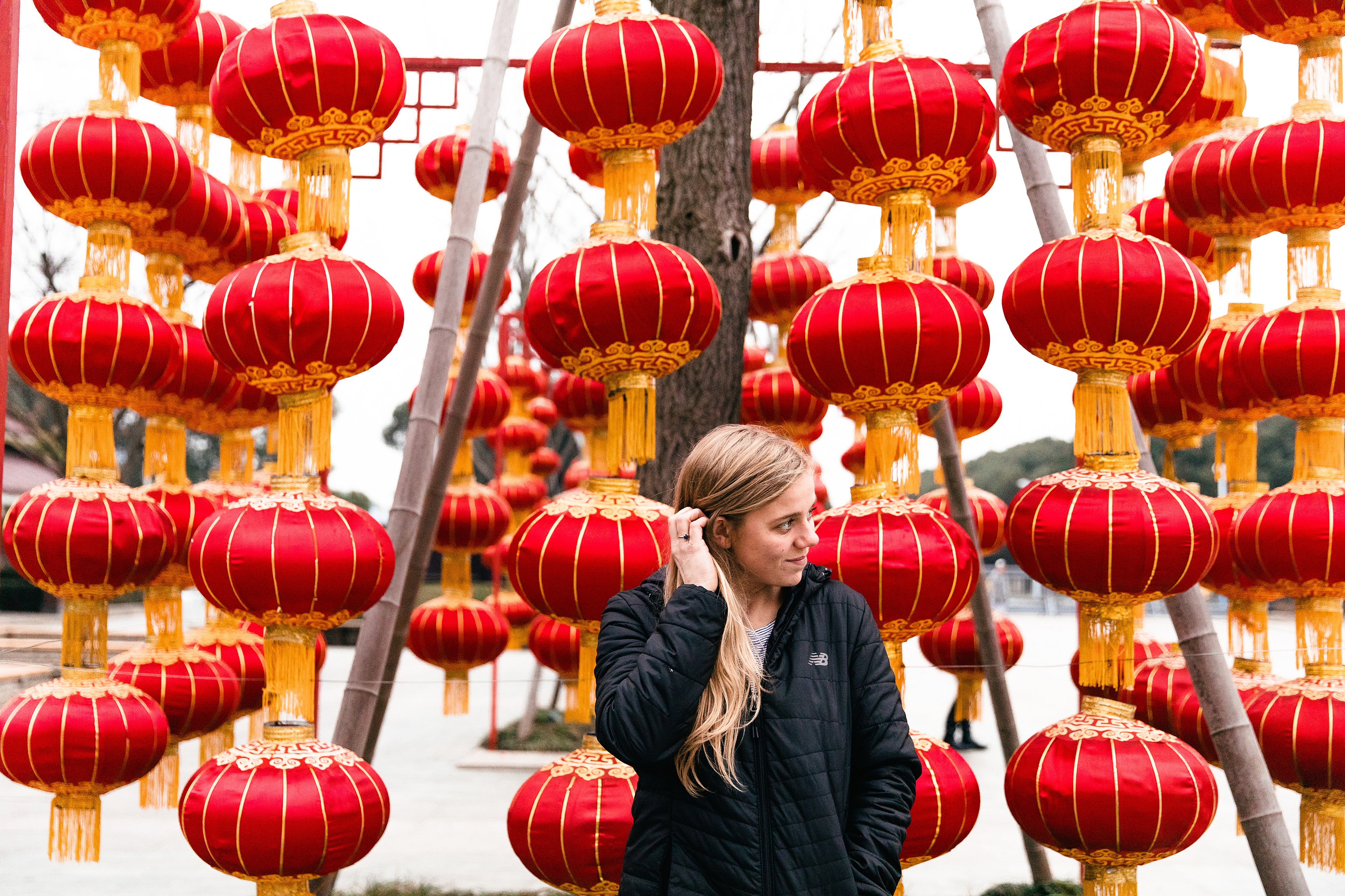 girl standing in front of Chinese lanterns
