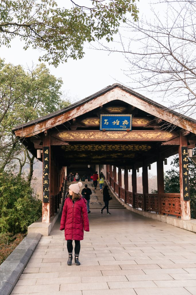 girl walking on Chinese bridge
