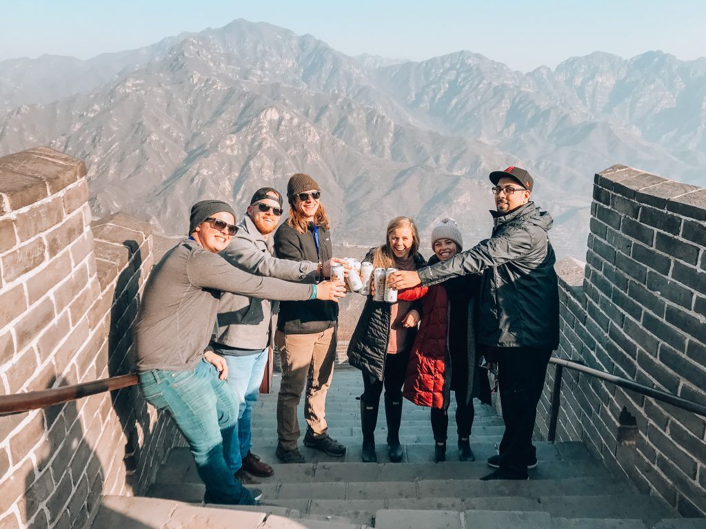 group drinking beer at the Great Wall of China