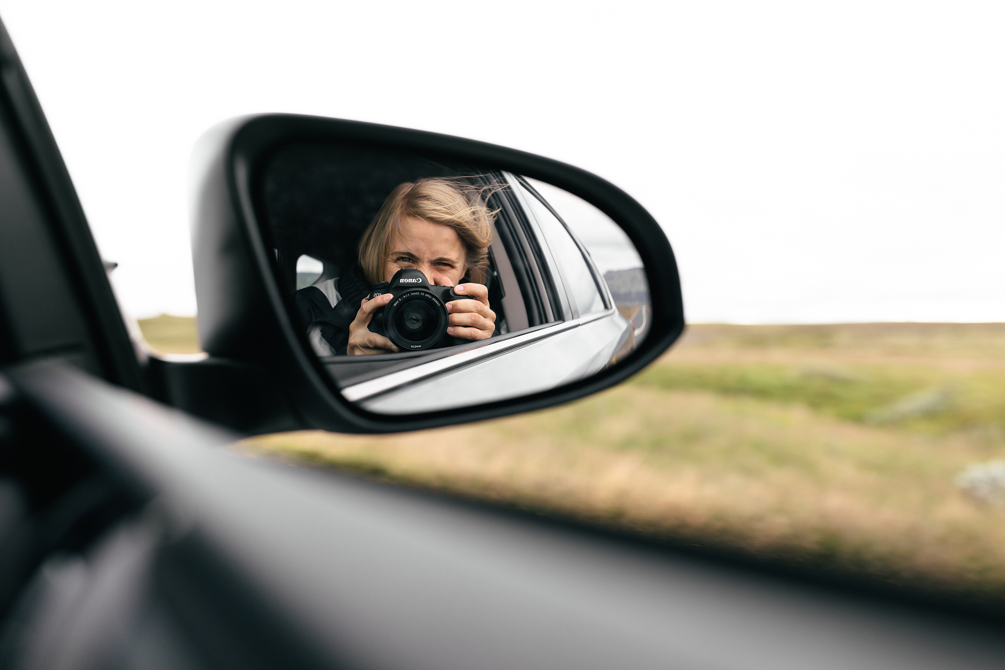 girl taking a photograph in iceland