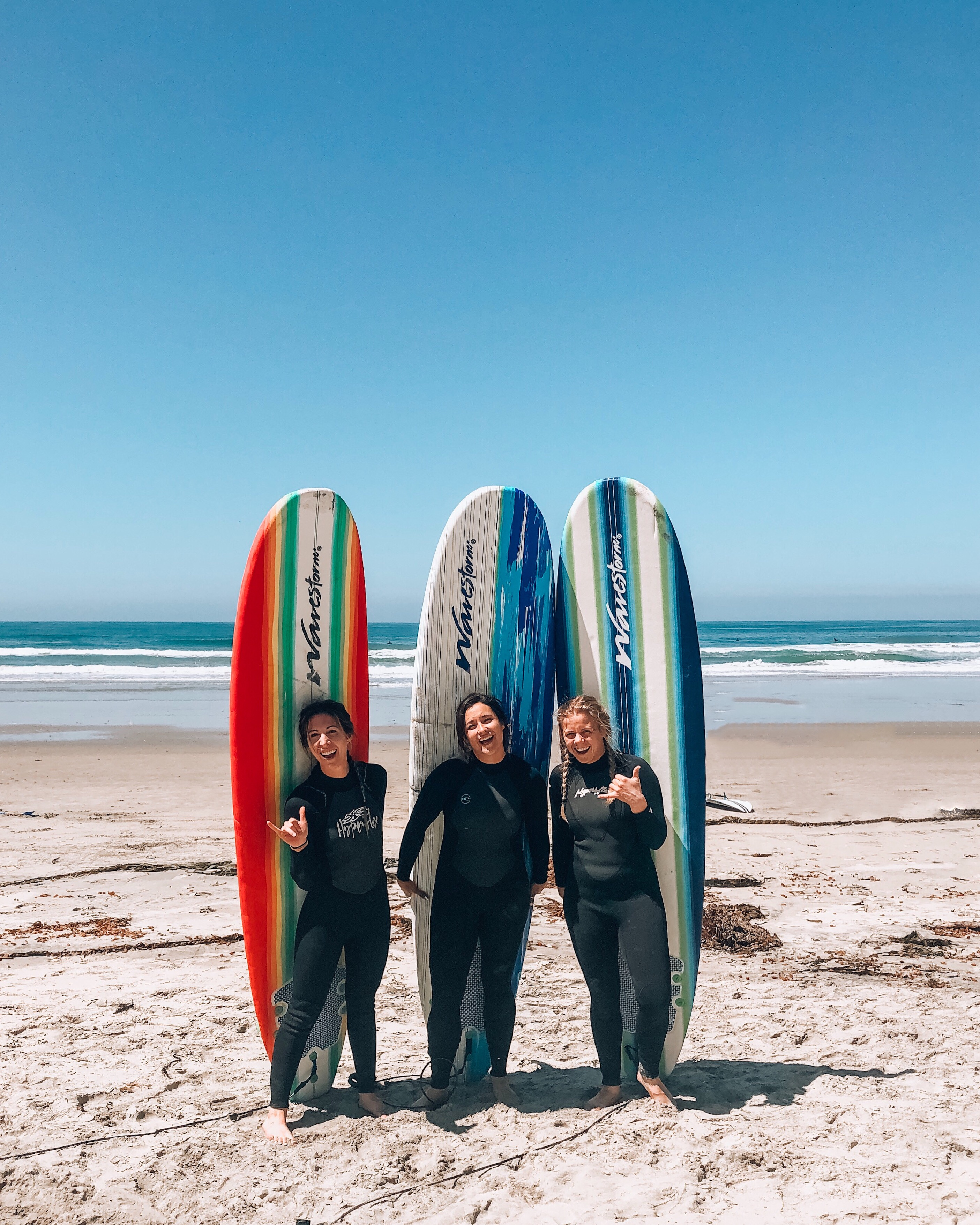 3 women with surfboards in Pacific Beach San Diego